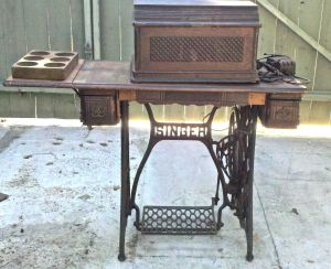 Treadle table, cover, accessories holder