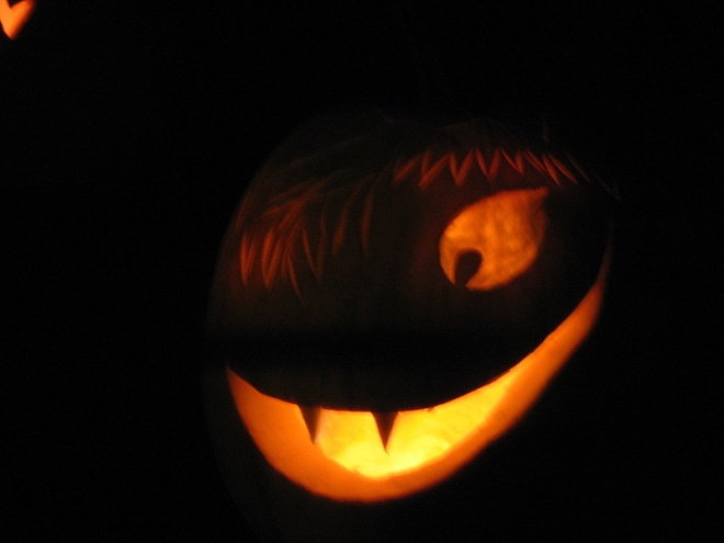 a jack o'lantern carved to look like a vampire