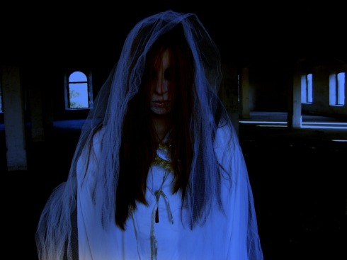 A ghostly woman in white, with blue lighting