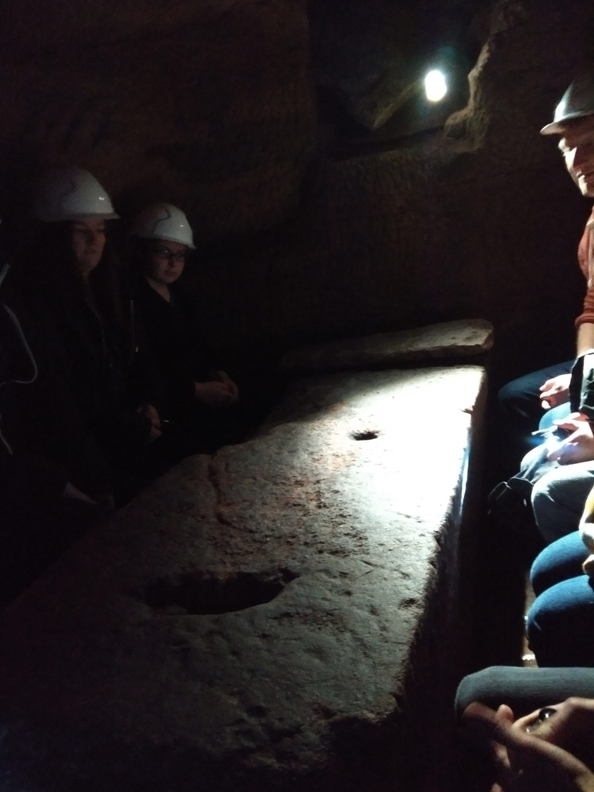 a stone table in an underground cove