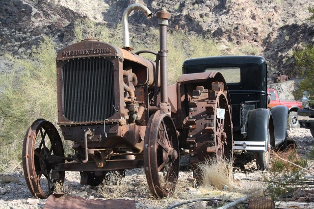 an abandoned and rusty tractor