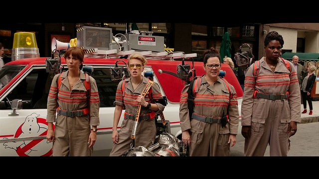 Cast of Ghostbusters 2016 in their gear