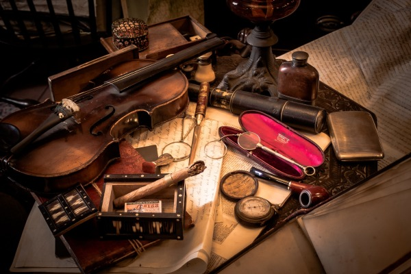 antique spectacles, violin, old watches, and a pipe