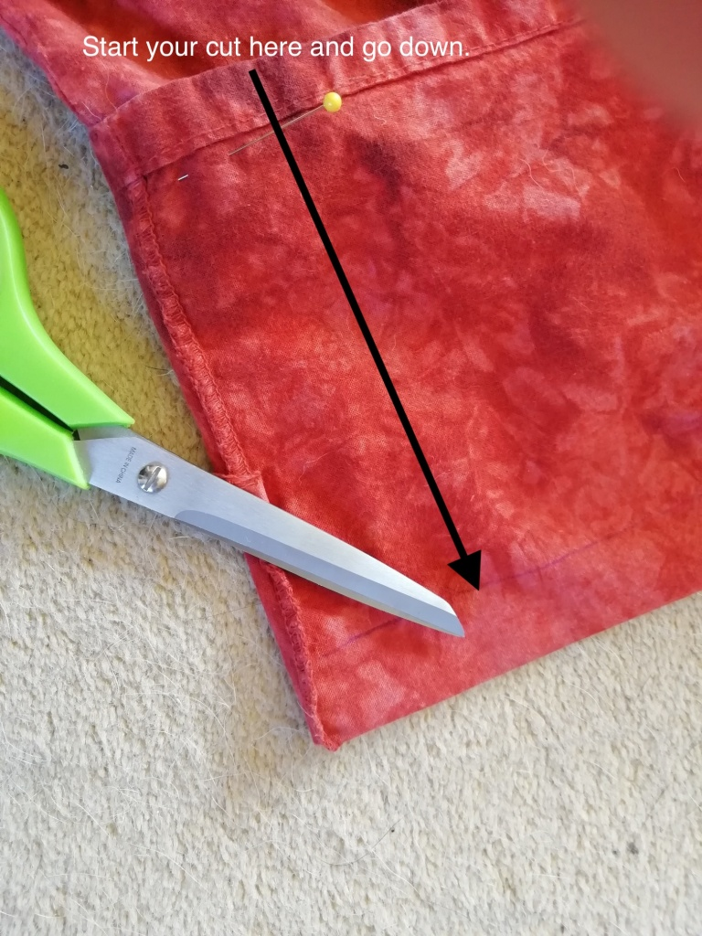 An arrow indicates the direction of the first cut.